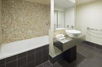 Bathroom Facilities in the Holiday Apartments - Mango Lagoon Resort & Spa Palm Cove