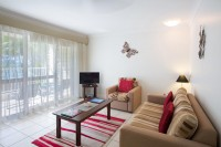 Spacious living areas with sofa bed within the self contained apartment