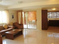 Open Plan Lounge with Outdoor Patio & BBQ - Palm Cove Holiday Apartment