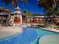Enjoy a refreshing dip in the large lagoon style swimming pool - - Private Palm Cove Holiday Apartment