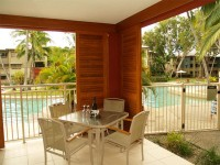 Patio overlooking Pool - - Private Palm Cove Holiday Apartment