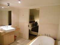Ensuite Bathroom with Spa Bath and Separate Shower