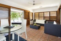 Beachfront Spa Suite with Spacious Living Area and Balcony overlooking Palm Cove Beach - Paradise On the Beach Resort Palm Cove
