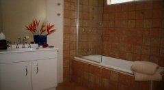 1 of 2 Bathrooms - Palm Cove Holiday House