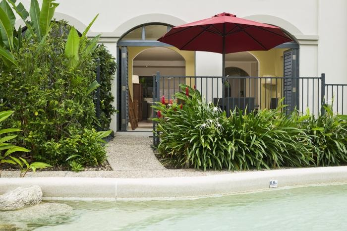 2 Bedroom Apartment Courtyard - some featuring Pool Access | Mango Lagoon Palm Cove Resort