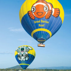 A parade of hot air balloons in Cairns