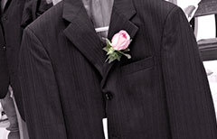 A Port Douglas grooms wedding coat and button hole