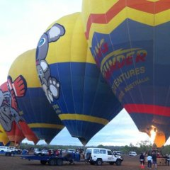 A visually spectacular scene of hot air balloons in Cairns