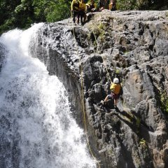 Abseiling Beside Flowing Waterfall - Cairns Canyoning Tour