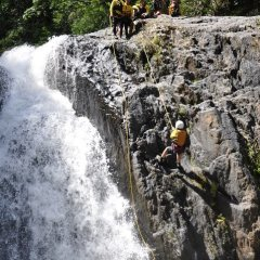 Abseiling Down a Waterfall - Cairns Canyoning Tour