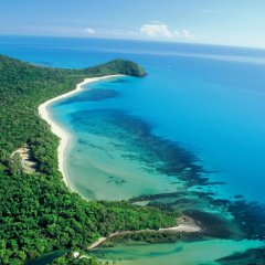 Aerial view Daintree and Great Barrier Reef coastline on Cairns scenic flights
