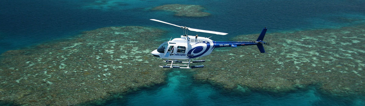 Aerial view of Cairns helicopter in flight over the Great Barrier Reef