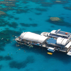 Aerial view of Great Barrier Reef pontoon and tour boat off Cairns