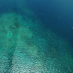 Great Barrier Reef Charter Boats - Aerial view of private charter boat on the Great Barrier Reef