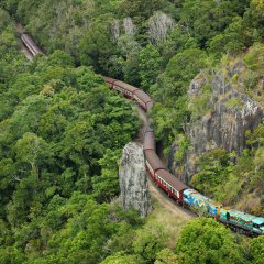 Aerial view of the Kurarnda Train winding its way up the mountain to Kuranda Village