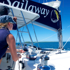 Deckand manning the sail on Low Isles Private Charter Tour Great Barrier Reef
