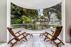 Enjoy views out to Palm Trees along the beach at Alamanda Palm Cove Private Apartment
