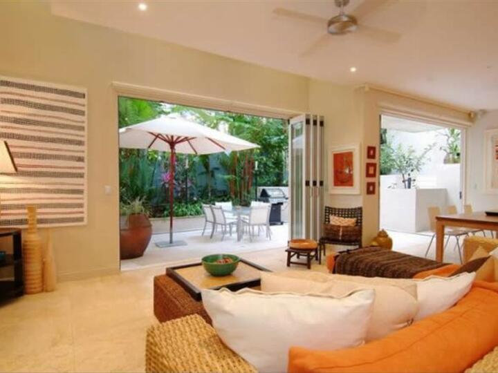 Port Douglas Apartments - Open plan Lounge and dining with private courtyard | Luxury Port Douglas Accommodation