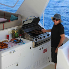 Barbeque on aft deck MV-A Cairns private charter boat