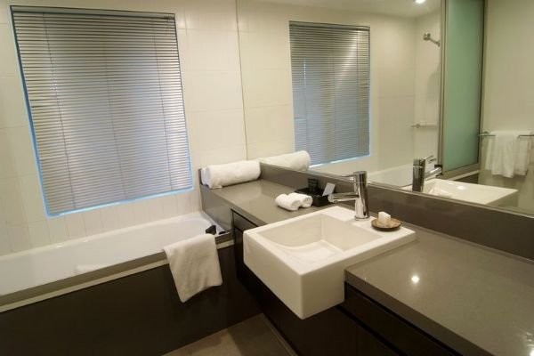 Bathroom with shower over bath in our Private Apartments