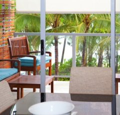 Relax on your private balcony with Ocean & Beach Views