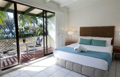 Bedroom with Ocean Views from the Balcony at Beachfront Terraces Port Douglas