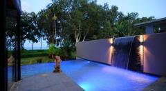 Bramston Beach Holiday Home - Pool lit up at night
