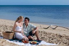 Cairns Accommodation - Couple on the Beach in Cairns