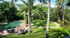 Unwind at Cairns Beach Resort surrounded by Tropical Gardens and ocean breezes