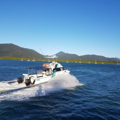 Cairns charter boat leaving for the Great Barrier Reef in Australia