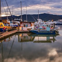 Cairns fishing boat moored in Cairns on sunset