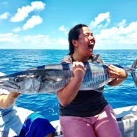 Cairns Reef Fishing - Very happy with her Spanish Mackeral