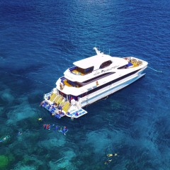 Cairns Reef Trips - Aerial View of Luxury Boat on the Reef