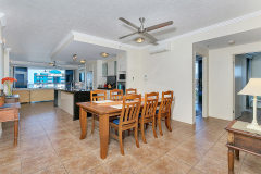 Open plan dining and living areas in your private apartment - Centre Point Apartments Cairns