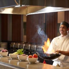 Chef Preparing Delicious Native Ingredients for Dinner Buffet