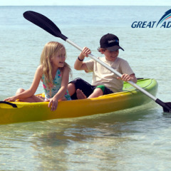 Children and families love kayaking around Green Island on a day trip to the Great Barrier Reef in Australia