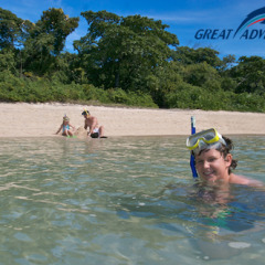 Children snorkelling at Green Island on the Great Barrier Reef in Queensland Australia