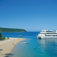 Great Barrier Reef Cruise ship moored near tropical island