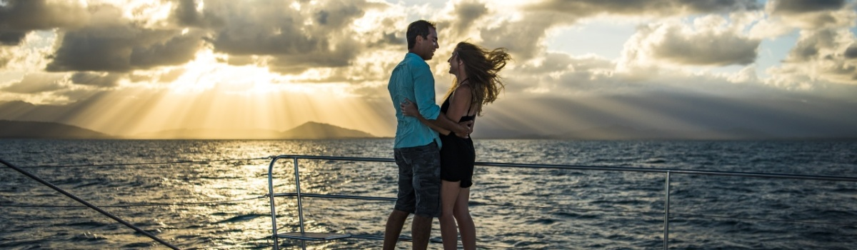 Couple enjoying a private charter sunset cruise on the Great Barrier Reef