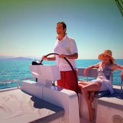 Couple relaxing on the upper deck of the private charter yacht on the Great Barrier Reef