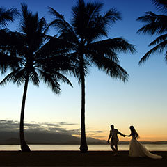 Couple stolling at sunset in Rex Smeal Park Port Douglas