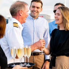Dinner Cruise guests being welcomed on board