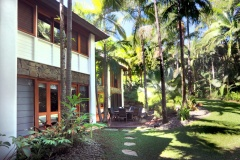 Downstairs Entertaining Area with grassy lawn and private gardens - Luxury Port Douglas Holiday Home