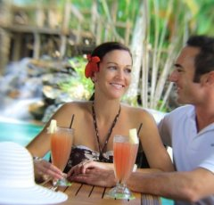 Enjoy a cool drink by the Resort Pool Bar