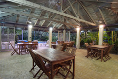Enjoy a Poolside BBQ at the Outdoor BBQ and Dining Guest Cabana