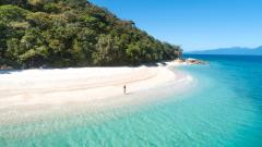 Enjoy a rainforest walk to Nudey Beach with soft sand and clear aqua waters | Fitzroy Island Resort, Cairns