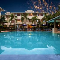 Enjoy a refreshing dip in the Swimming Pool (Heated in Winter) - Cayman Villas Luxury Port Douglas Holiday Apartments