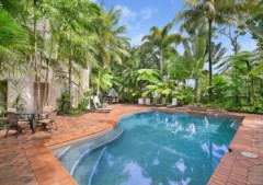 Enjoy a refreshing dip in the tropical swimming pool after a day exploring Cairns