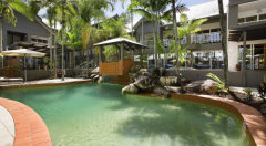 Enjoy a refreshing swim in the tropical Swimming Pool & Spa - Paradise On the Beach Palm Cove
