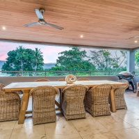 Enjoy alfresco dining in your private balcony in this luxurious Port Douglas Holiday Home